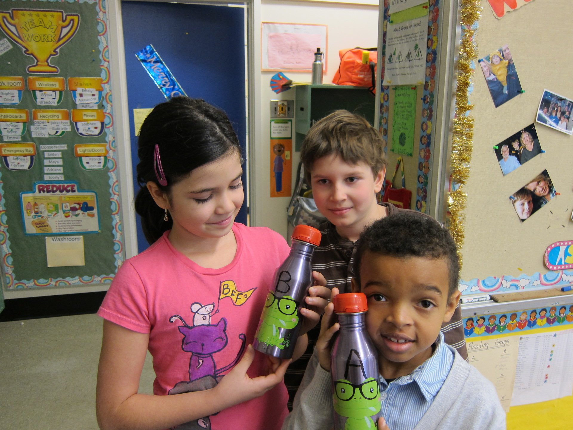 Grade 4 students proudly display their reusable water bottles.